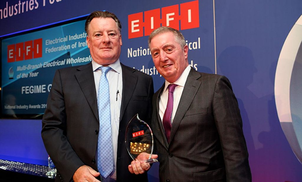 Fegime got the Best Multi-Branch Wholesaler Award at the EIFI Event. Peadar Conlon, President of Fegime Ireland receives the award from Ciaran O'Reilly of ATC